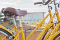 cambria beach lodge sign and yellow bikes