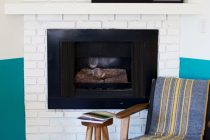 suite living fireplace and chair